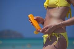 Applying Sunscreen Royalty Free Stock Photos