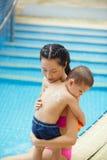 Applying suntan lotion Royalty Free Stock Photo
