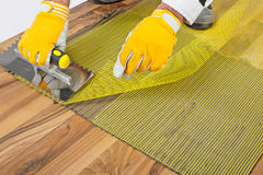Applying tile adhesive with mesh Royalty Free Stock Photos