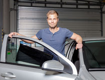 Applying tinting foil onto a car window Royalty Free Stock Images