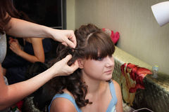 Applying wedding hairstyle Stock Images