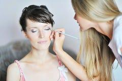 Applying wedding make-up Stock Photo