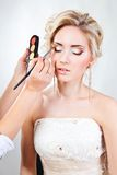 Applying wedding makeup Stock Photos
