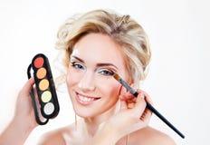 Applying wedding makeup Stock Images