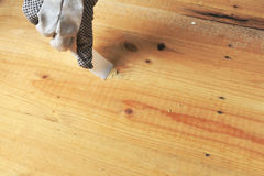 Applying wood filler Royalty Free Stock Image