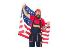 Applying for work visa USA. Man bearded laborer hold american flag. Repair and renovation. Repair tips. Guy worker in. Hard hat. Builder regular worker. Quick stock photography