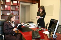 Appointment 14. Two woman speak and write in a office Stock Photo