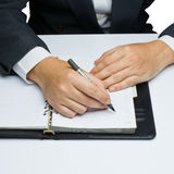 Appointment. Businessman makes an appointment on notebook stock images