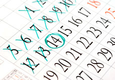Appointment. Calendar with crossed dates and one encircled Stock Photography