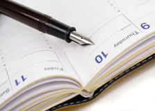 Appointment book. Open agenda with fountain pen resting on page royalty free stock images