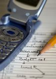Appointment Book 2. A cell phone lays on top of the daily appointment book stock photography