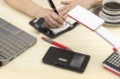 Appointment book. A person takes notes in the appointment book Royalty Free Stock Images