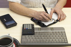 Appointment book. A person takes notes in the appointment book Royalty Free Stock Photo