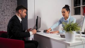 Appointment between a businesswoman and a businessman in the office stock video