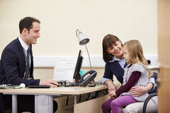 Appointment For Mother And Daughter With Doctor Stock Photo