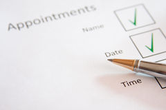 Appointment page. White page with Appointments and pen with check boxes royalty free stock photography