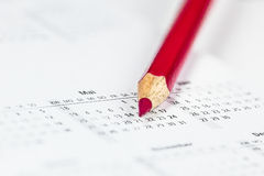 Appointment. Red pencil marks an appointment in diary Royalty Free Stock Photography