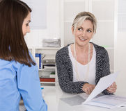 Appointment at a specialist for finance: female customer and adv Stock Photos