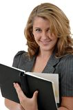 Appointments. A woman looking through her appointment book Stock Image