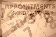 Appointments. In camera multiple exposure. Appointments,rendezvous,months,days of week. Sepia toned Stock Images