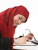 Appointments. Young veiled business woman making appointments in her agenda Stock Images