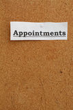 Appointments on cork board Royalty Free Stock Images