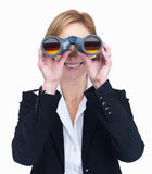 Apppppged businesswoman looking through binoculars Royalty Free Stock Images