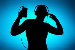 Appréciez la musique, silhouette sur le bleu Illustration de Vecteur
