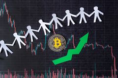 Appreciation of virtual money bitcoin. Green arrow and silver Bitcoin on paper forex chart index rating go up exchange market royalty free stock images