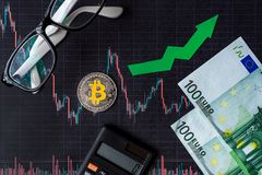 Appreciation of virtual money bitcoin. Green arrow and silver Bitcoin on paper forex chart index rating go up exchange market. Background with euro banknotes stock photography