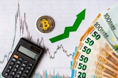 Appreciation of virtual money bitcoin. Green arrow and silver Bitcoin on paper forex chart index rating go up exchange market. Background with euro banknotes royalty free stock photography