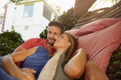 Appreciative young couple relaxing on a hammock together Royalty Free Stock Photos