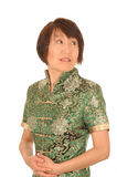 Apprehensive Asian woman. Young Asian woman looking apprehensive on a white background royalty free stock images