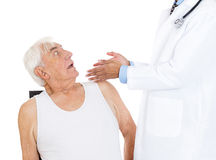 Apprehensive old man undegoing medical examination Royalty Free Stock Images