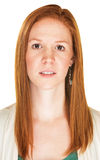 Apprehensive Woman. Cautious young European female with red hair over white royalty free stock photos