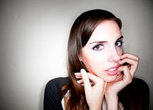 Apprehensive Young Woman. Holding Hand to her Face royalty free stock photo