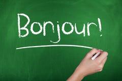 Apprendimento delle lingue francesi Bonjour ciao fotografia stock libera da diritti
