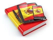 Apprendimento spagnolo Dispositivi mobili, smartphone, pc della compressa e libro Immagini Stock