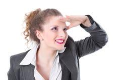 Apprendisti che guardano in avanti al futuro - donna isolata sul BAC bianco Immagini Stock