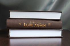 Apprenez à aimer encore. Réservez le concept. Photographie stock libre de droits