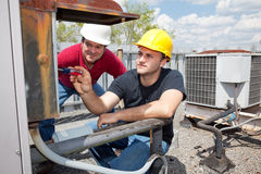Apprentice Air Conditioning Repairman Royalty Free Stock Images