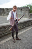 An Apprentice Boy with his musket re-enacting the defense of the walls of the Maiden City during the Siege of  Derry 1688-1689  as Stock Image