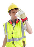 Apprentice builder drinking ice cold water. Apprentice trainee builder construction worker drinking ice cold water. White background royalty free stock photo
