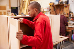 Apprentice Building Furniture In Carpentry Workshop Royalty Free Stock Photos