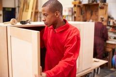 Apprentice Building Furniture In Carpentry Workshop Stock Photos