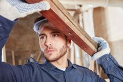 Apprentice of carpentry. Woodworking and learning Royalty Free Stock Image