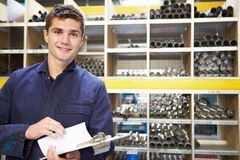 Apprentice Checking Stock Levels In Store Room Stock Photography