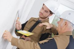 Apprentice construction worker learning with instructor. Apprentice stock photo