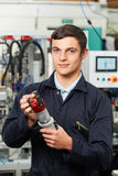 Apprentice Engineer Checking Component In Factory Stock Photo