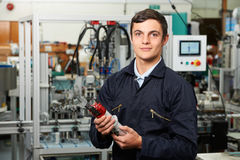Apprentice Engineer Checking Component In Factory Royalty Free Stock Photography